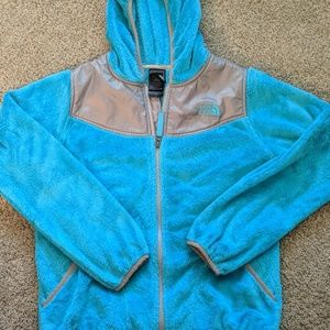 The North Face girls Lg turquoise hooded jacket.
